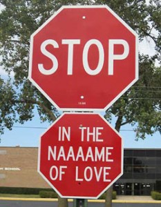 stop sign with second sign saying in the naaaame of love
