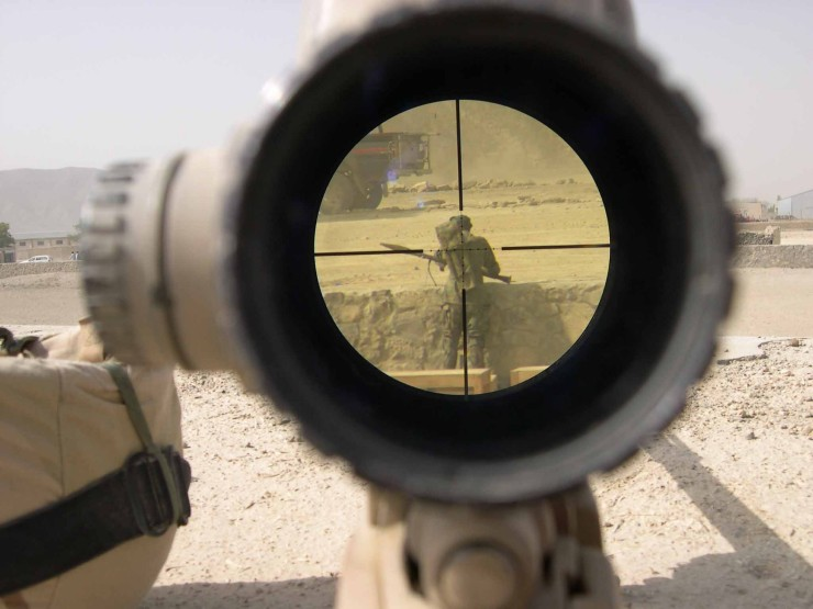soldier in the scope of rifle