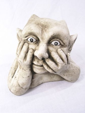 gargoyle with hands on face