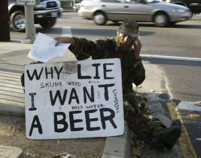 beggar with want a beer sign