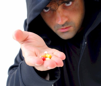 man offering pills