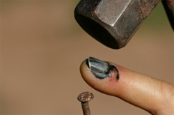 hitting finger with hammer