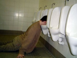 guy unconscious with head in urinal