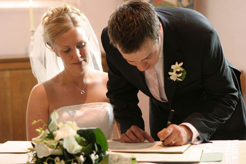 newly married signing wedding register
