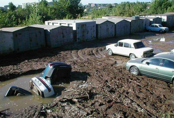 cars in mud hole