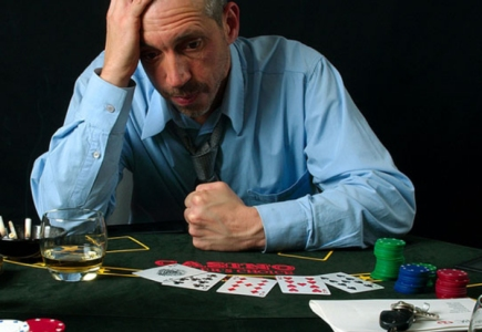 man with gambling problem at card table