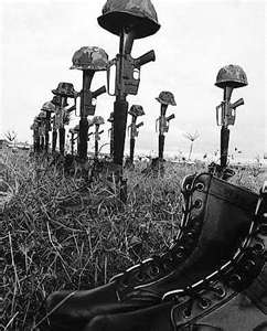 war memorial of guns with helmets on them