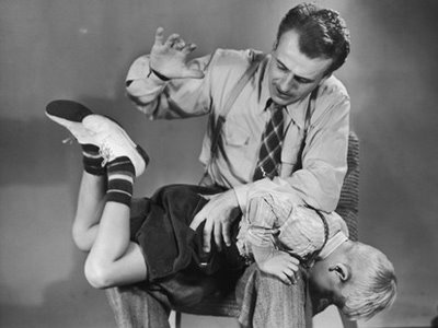 man spanking boy